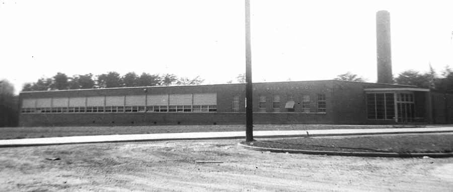 Black and white photograph of Drew-Smith Elementary School. The building is a single-story concrete structure with a brick veneer. It has much fewer classrooms and fewer amenities than the schools built for white children during this time period.