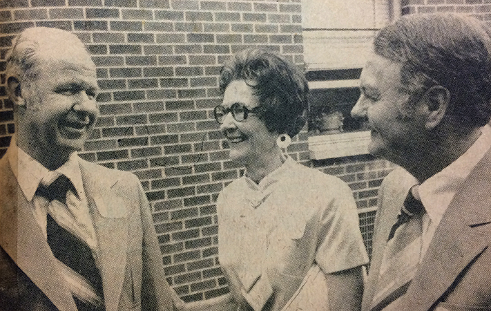 Black and white photograph that appeared in the Alexandria Gazette newspaper on May 25, 1978. The photograph shows three individuals, William Jack Burkholder, Rose S. Rogers, and Joseph B. Hucks, standing outside Rose Hill Elementary School.