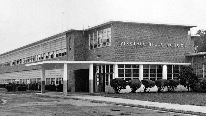 Black and white photograph of Virginia Hill Elementary School from this school's 1971 to 1972 yearbook. The building is two-stories tall with an office suite near the main entrance. The building's egg-crate design, as described by architects, is very similar to Mount Eagle Elementary School which opened during the same time period.